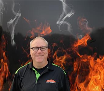 Crew member steve standing against fake fire backdrop