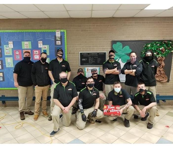 photo of servpro crew in masks at local school
